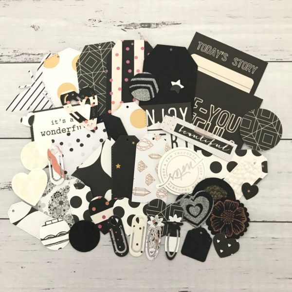 Black, white and foiled die cut pack